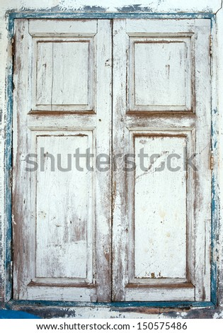 Wooden window shutters - Closed old shuttered weathered  - stock photo