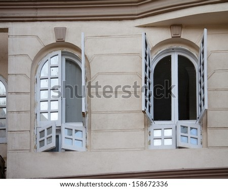 Wooden window with half arc