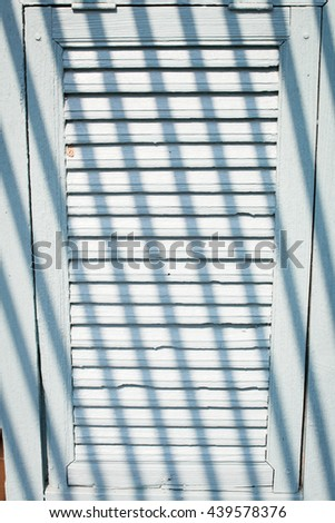 wooden window with light and shadow