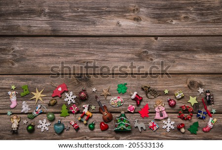 Wooden xmas or christmas background with colorful decoration of miniatures. - stock photo