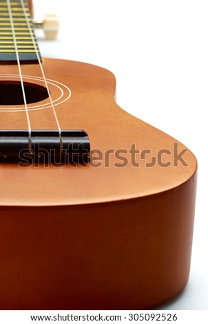 Wooden yellow acoustic guitar on white background - stock photo