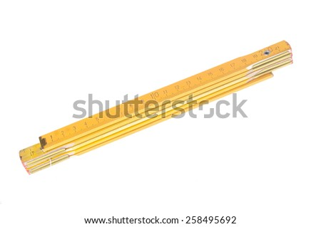 wooden yellow measure isolated on white  - stock photo