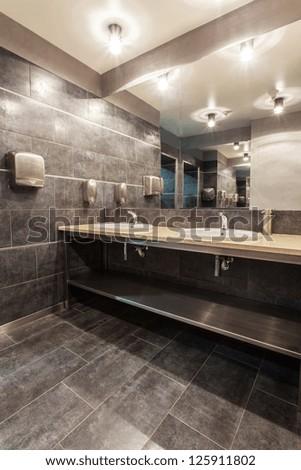 Woodland hotel - Bathroom with two wash basins - stock photo