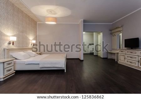 Woodland hotel - Interior of luxurious modern bedroom - stock photo