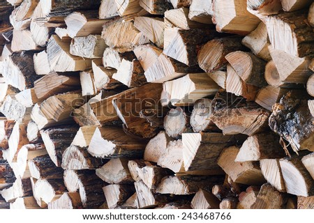 Woodpile from dry oak logs. Selective focus. For use as nature background. - stock photo