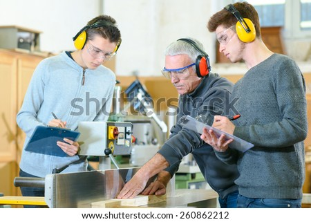 Woodwork apprenticeship - stock photo