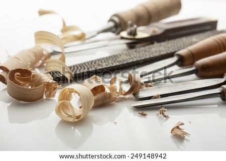 woodworker tools  and shavings on white bord - stock photo