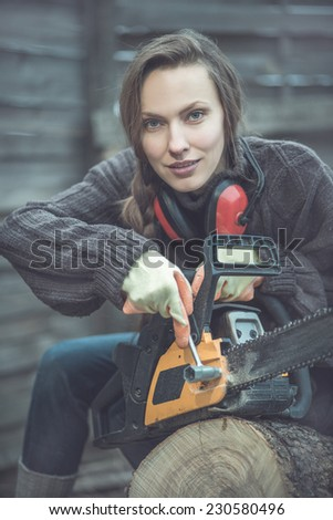woodworker with chainsaw. toned old image - stock photo