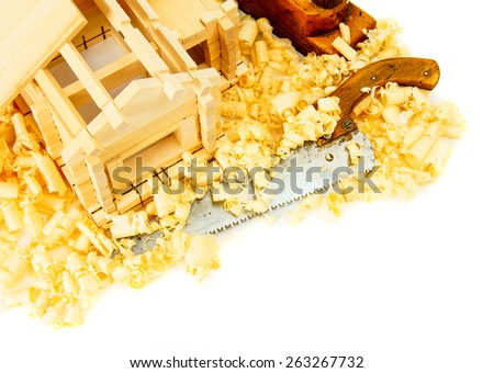 Woodworking. House construction. Joiner's works. The small wooden house, saw, plane and shaving on white background. - stock photo
