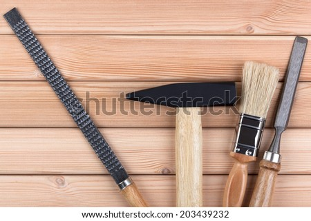 Woodworking tools on a wooden background. - stock photo
