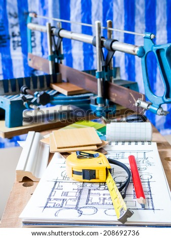 Woodworking tools with architectural drawing  in workshop - Home improvement - stock photo