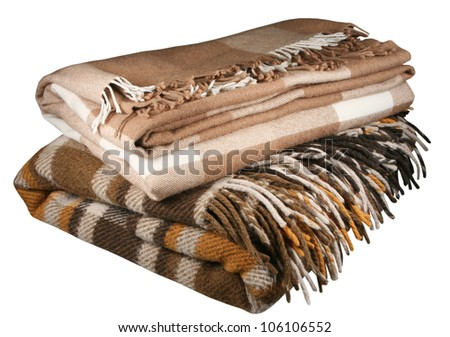 Woolen checkered plaid on a white background - stock photo