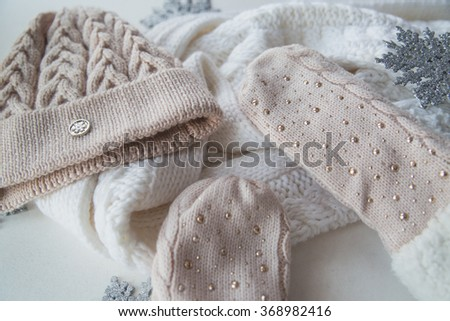 woolen light blue scarf, gloves and hat over white - stock photo