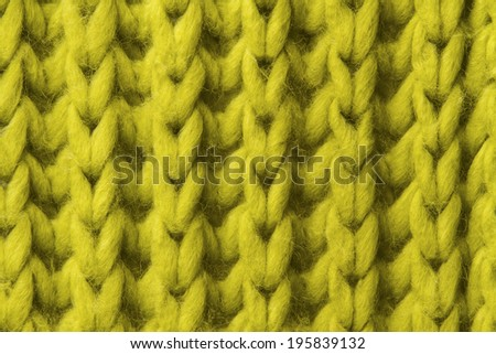woolen texture background, knitted wool fabric, green hairy fluffy textile  - stock photo