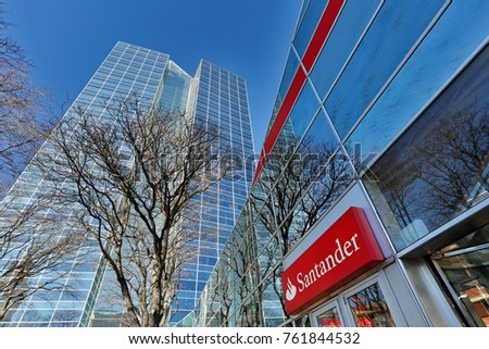 Worcester, Massachusetts, USA - November 23, 2017:  A Santander Bank branch on a sunny morning.  Santander Bank is a wholly owned subsidiary of the Spanish Santander Group and is based in Boston.