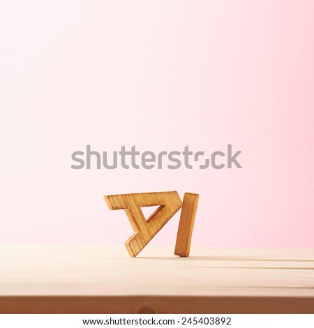 Word Ai meaning Love in Chinese language as a composition of wooden block letters against the pink background - stock photo