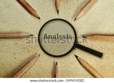 Word Analysis under a magnifying glass on vintage background - stock photo