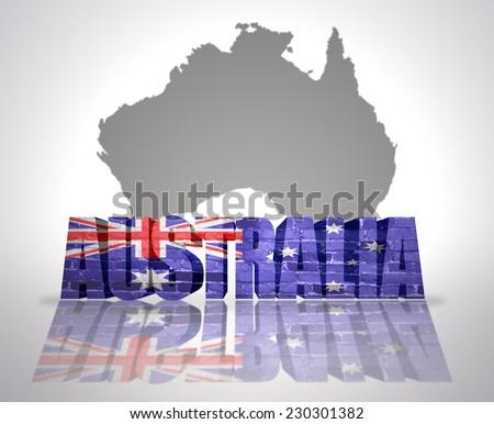 Word Australia with National Flag near map of Australia - stock photo