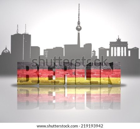 Word Berlin with national flag of Germany near skyline silhouette - stock photo