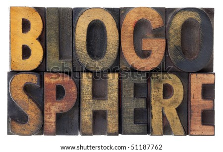 word blogosphere (global blog community) in vintage wood letterpress types, stained by ink, isolated on white