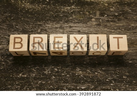 word BREXIT on a wooden background - stock photo