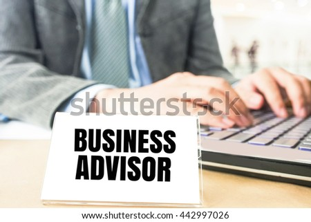 word business advisor white card on blurred business man using computer laptop office desk background - stock photo