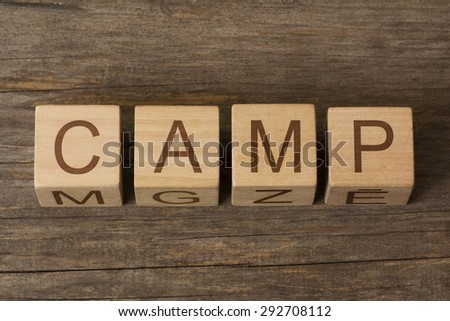 word camp on a wooden cubes - stock photo
