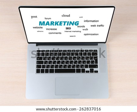 Word cloud in laptop. Marketing concept - stock photo