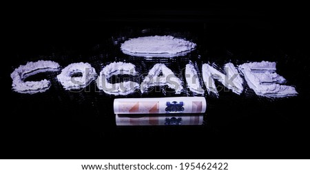 Word Cocaine, a pile of white drug and 50 euro note on a mirror  - stock photo