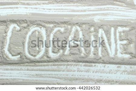 Word Cocaine written over white powder