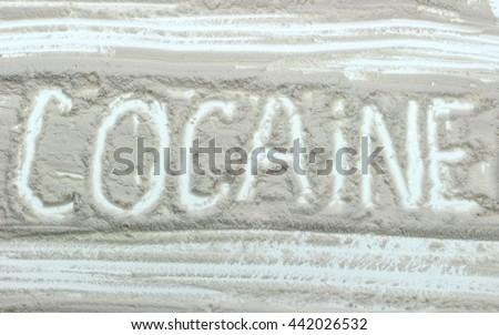 Word Cocaine written over white powder - stock photo