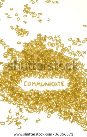 word COMMUNICATE created with food letters, white background, vertical photo - stock photo