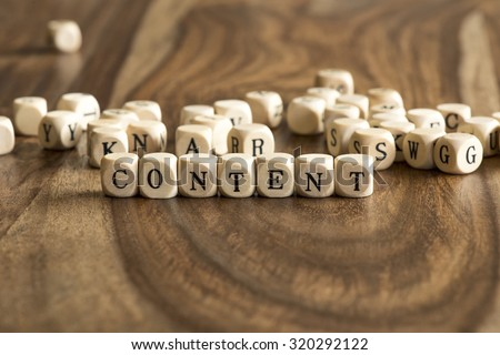 Word CONTENT made with block wooden letters over the wooden board surface - stock photo