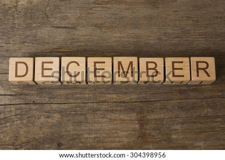 word DECEMBER on a wooden cubes - stock photo