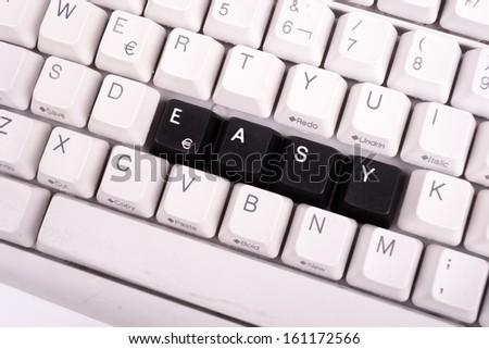 Word Easy written with black keys on computer keyboard. - stock photo