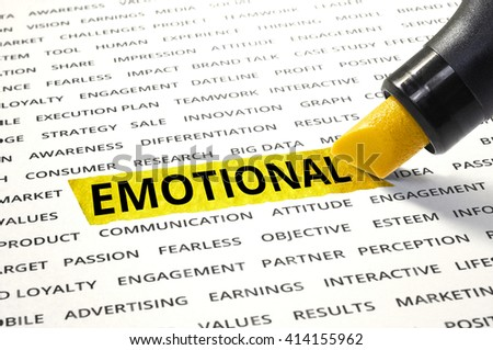 Word Emotional highlighted with marker on paper of other related words. For direction of business marketing concept - stock photo