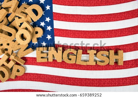 word English in cork letters on American flag