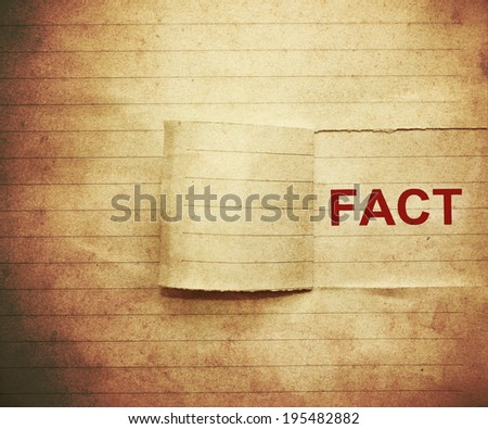 "word ""fact"" on the paper in vintage style - stock photo"