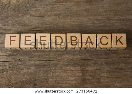 word feedback on a wooden background - stock photo