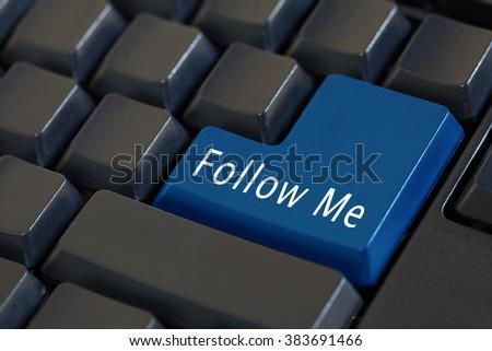 Word 'Follow Me' on enter keyboard - social media concept - stock photo