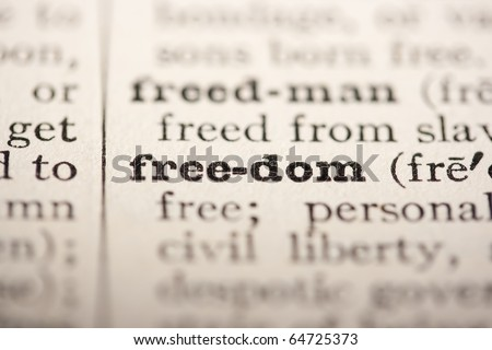 Word freedom from the old dictionary, a close up. - stock photo