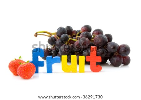 Word Fruit with strawberry and grapes isolated on white background