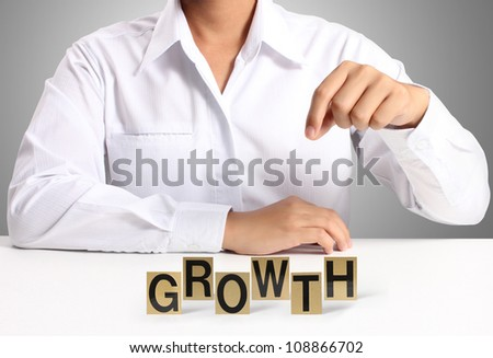 word growth in hand, businessman - stock photo
