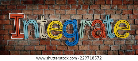 Word Integrate and Brick Wall in the Back - stock photo