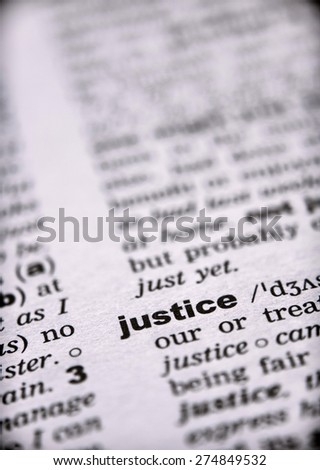 Word justice in dictionary - stock photo