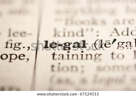 Word legal from the old dictionary, a close up. - stock photo