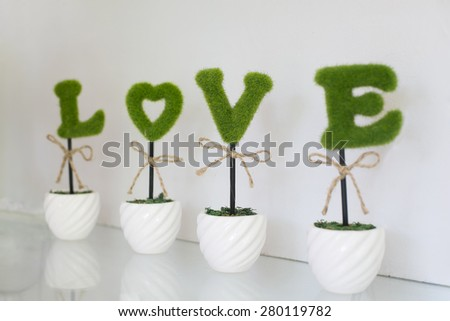 word love and decoration details over white, wedding decor - stock photo