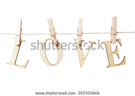 Word Love hanging on a line with clothes pags over white background