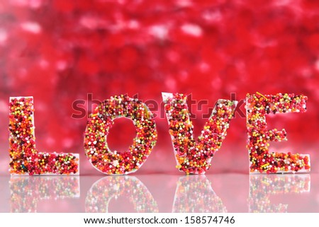 """Word """"Love"""" on red background - stock photo"""