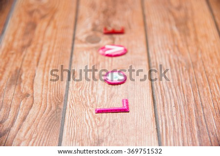 Word Love on wooden background.Sweet holiday,Happy Valentines day, wedding day, Mother's day, Anniversary for special person.Text on vertical of frame. - stock photo